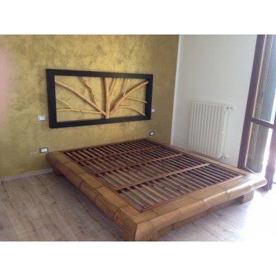 rete fissa in bambù tinta miele antico appoggiata su giroletto Virunga, testiera Ramo